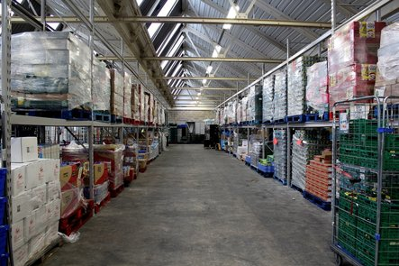 massive warehouse, divided into aisles by huge steel beams.